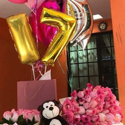 fotografía fiesta sorpresa para amiga con globos